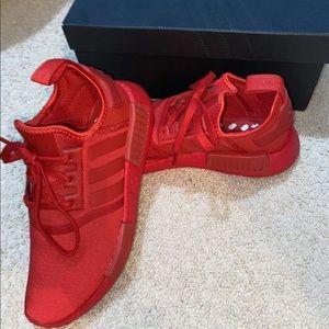 Red adidas NMDs